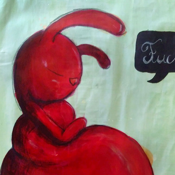 Red rabbit on green